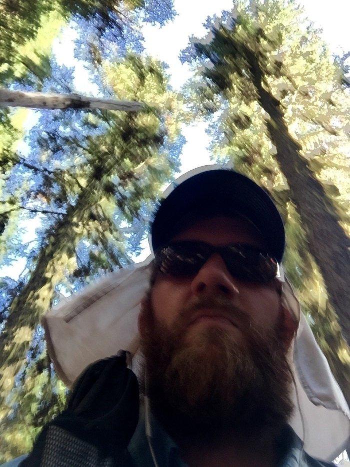 Action shot selfie of Mountain Man hiking