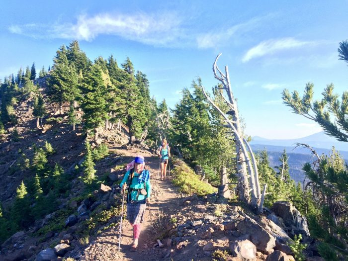 Sweet Pea and Gazelle hiking on a high rocky ridge