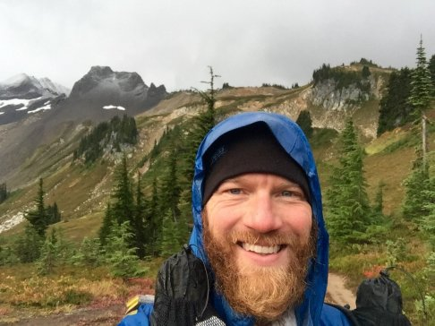 Mountain Man smiling despite an early morning rain on the PCT