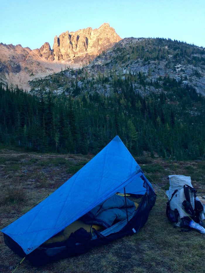 Tent pitched in an alpine meadow along the PCT