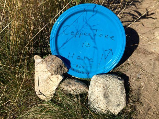 Plastic plate announcing Coppertone trail magic
