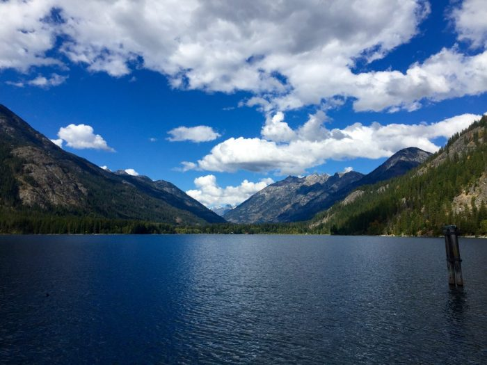 Blue sky and puffy white clouds above the North Cascades and Lake Chelan