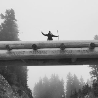 Mountain Man crossing a wooden bridge over the highway at Chinook Pass