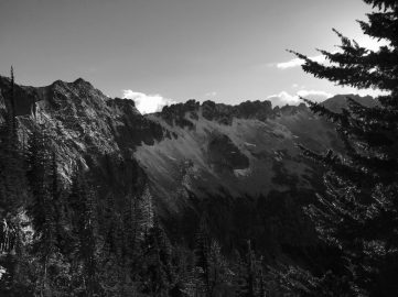 Black and white ridge with dusting of snow extending from Granite Pass