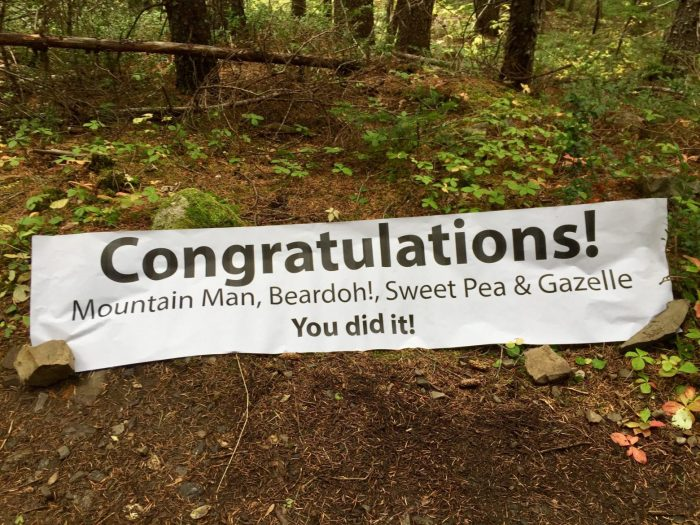 Banner congratulating Mountain Man, Gazelle, Beardoh, and Sweet Pea on finishing the PCT