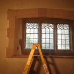 Place of worship window repair after stone repair using colour matched stone and pointing