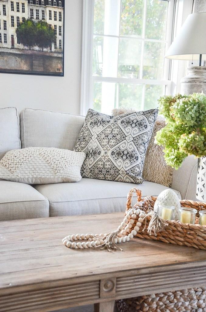 neutral pillow on a white sofa