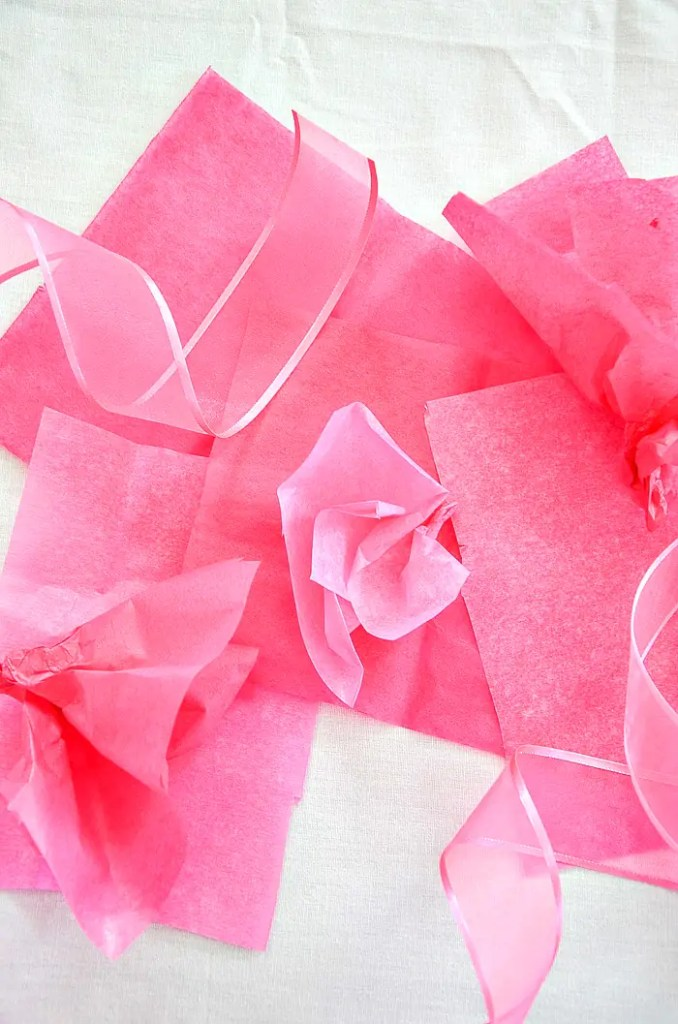 pink and red tissue paper and ribbon