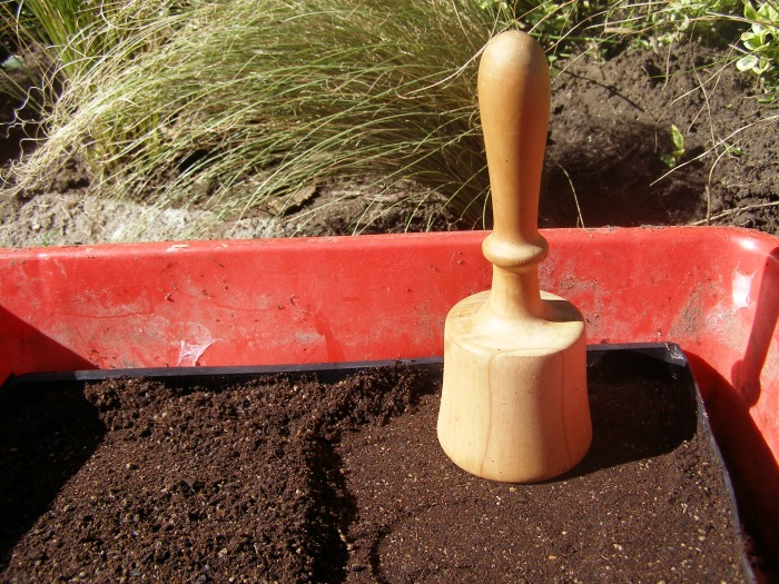 Old English potato masher turned soil patter