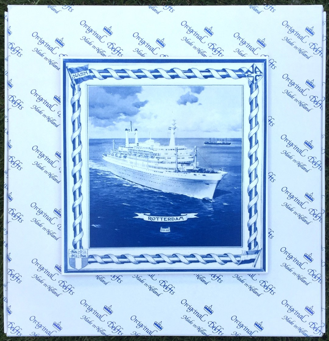 Delft blue plate and tile to commemorate the maiden voyage of the ss Rotterdam