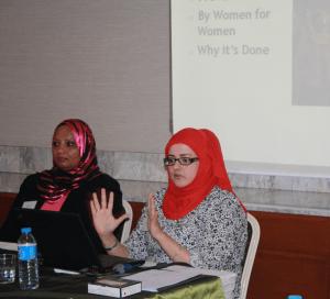 Susan Al Shahri and Habiba Al Hinai explaining Oman