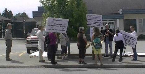 Marchers gather outside of BC Hydro office in Powell River-B
