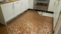 Kitchen floor made with one penny coins