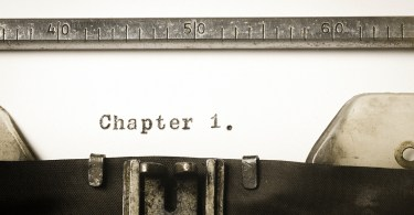 Typewriter showing 'Chapter 1' typed on page