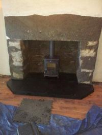 Enlarging a fireplace opening for a wood burning stove ...