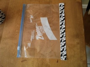 Wrap bag with tape lengthwise