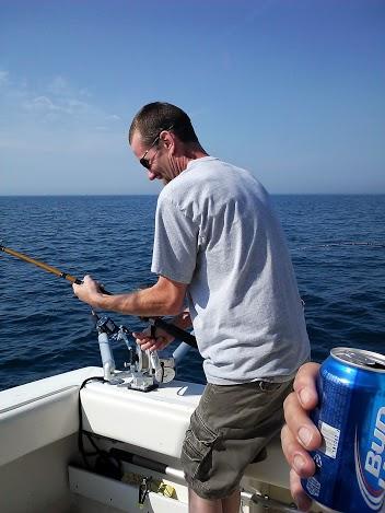 reeling in biggest catch-charter-fishing-lake michigan