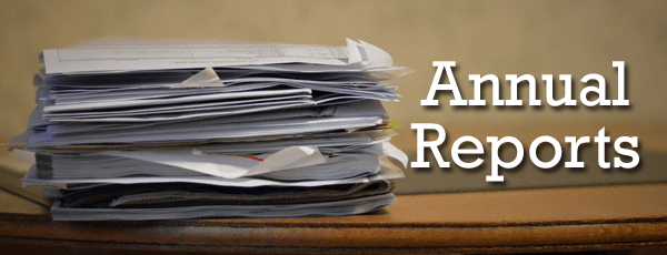 Image of reports piled on a desk