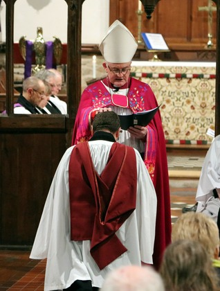 Bishop Christopher blesses Keith