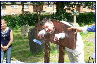 Photo of Chris F in the stocks at the Armada Celebration