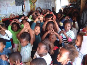 Photo of small children doing actions to a song