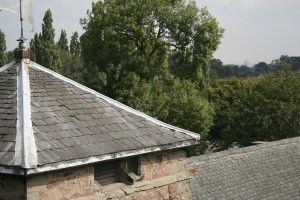 Photo: Loose and missing slates on the church tower