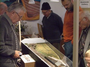Photo: George Loydall running a train into his model of Helston Station