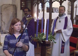 Photo: Rose lighting the Advent Candle