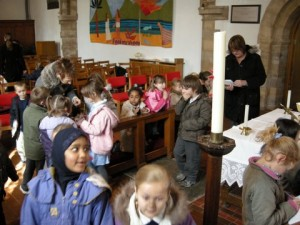Photo: Pupils exploring the church, round the communion table