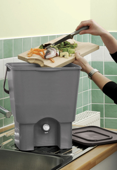 kitchen composter tuscan ideas straight ltd a women emtying food waste into