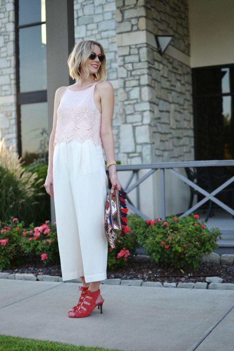 lookbook blush top, cream culottes, sole society tassel clutch and heels, raen sunglasses