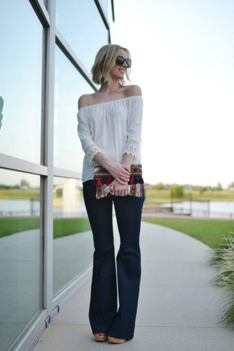flare jeans, off the shoulder top, platforms