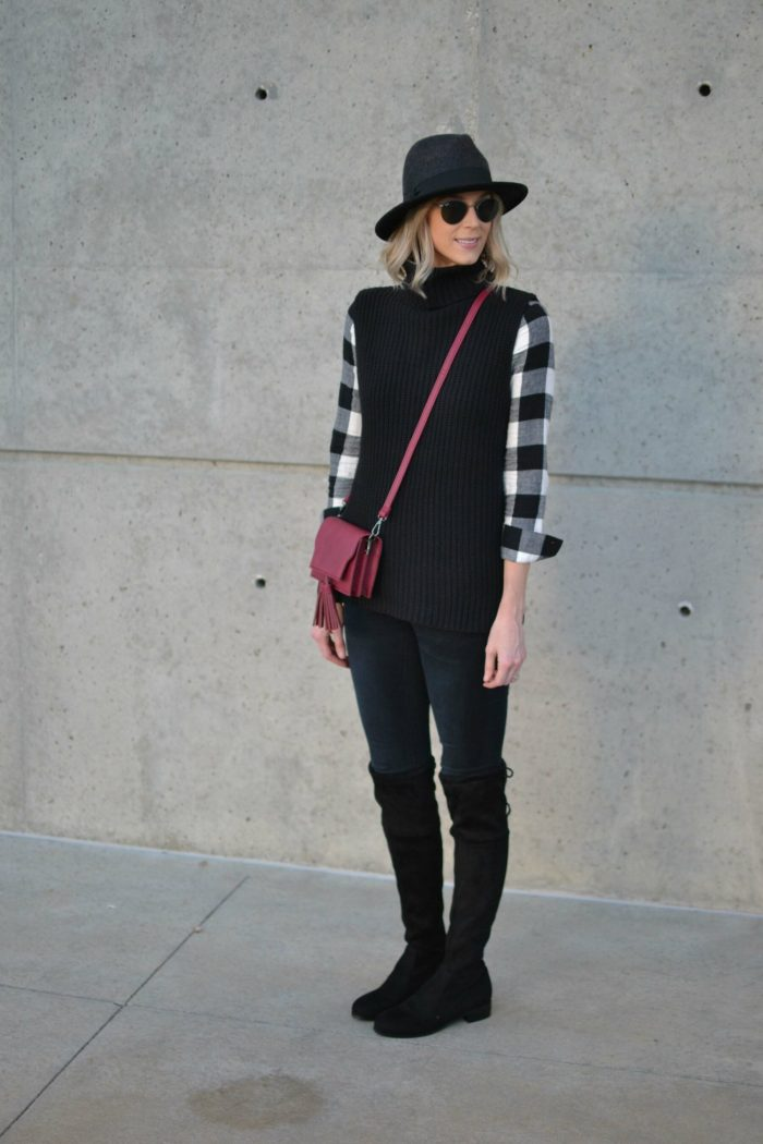 OTK boots, black jeans, plaid shirt, hat, ray-bans
