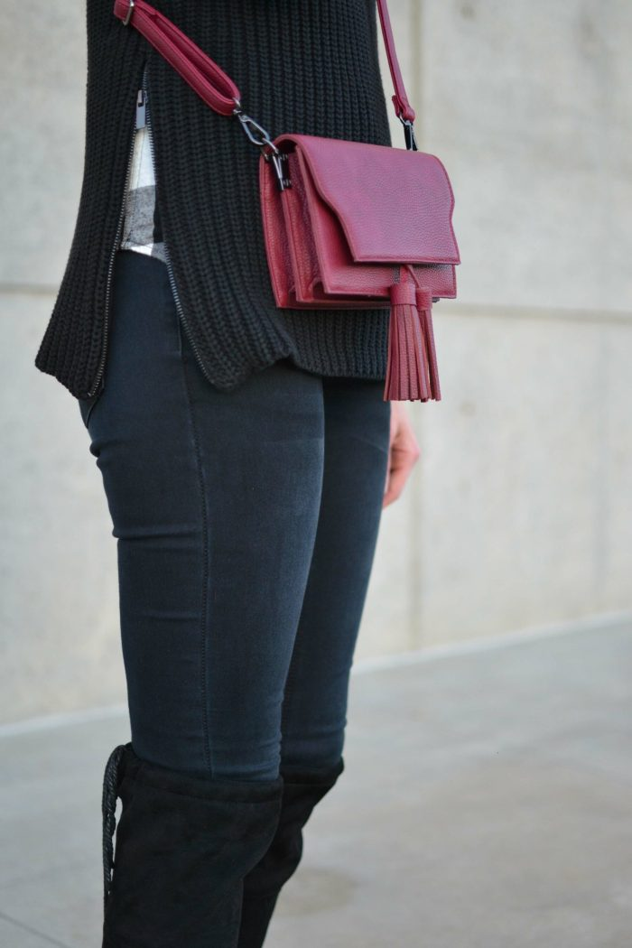 OTK boots, black jeans, plaid shirt, hat, red tassel bag