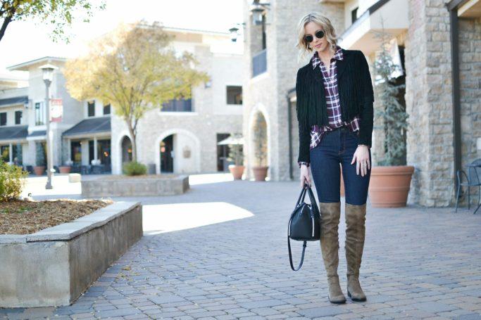 WAYF plaid shirt, OTK boots, jeans, fringe jacket