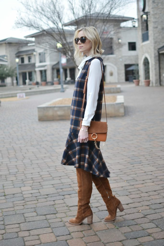 Chicwish plaid shift dress, white bow blouse, cognac Dolce Vita over the knee boots