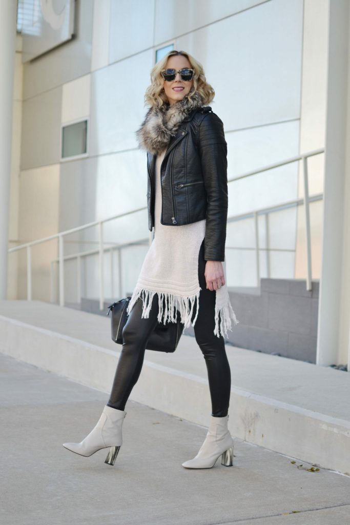 fringe hem tunic sweater, leather jacket, faux fur scarf, leather leggings, cream mod style booties