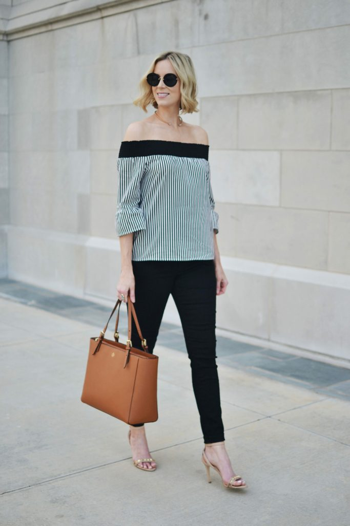 black and white striped OTS top, black jeans, tan Tory Burch tote