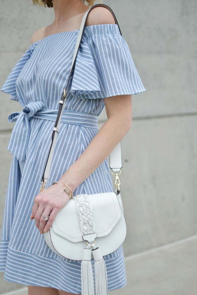 blue and white striped off the shoulder dress, white lace up flats, white tassel bag