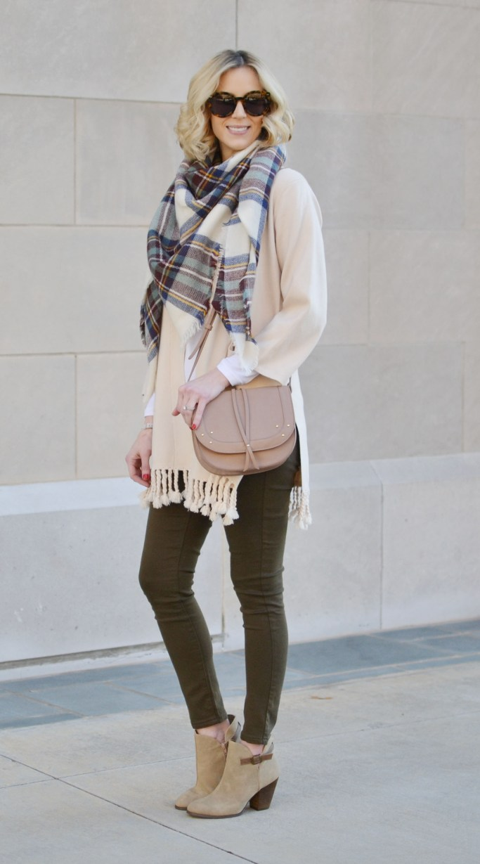 casual fall outfit idea, olive green skinny jeans, fringe cardigan, blanket scarf, Restricted Shoes booties