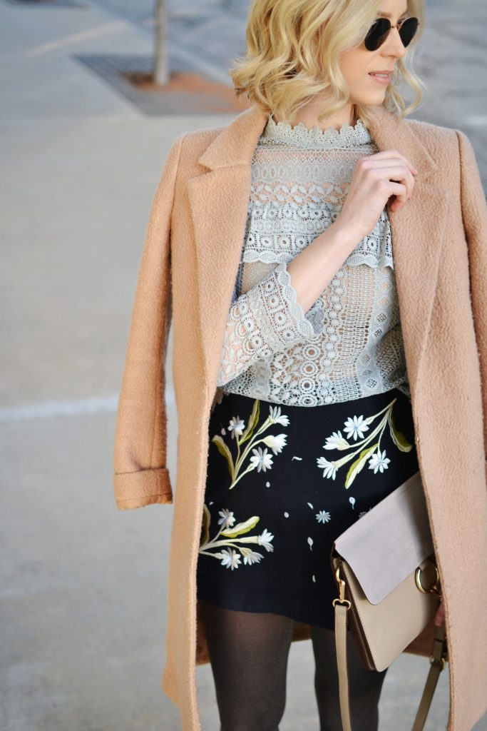 embroidered skirt and lace top with camel coat tights and boots, winter date night outfit idea