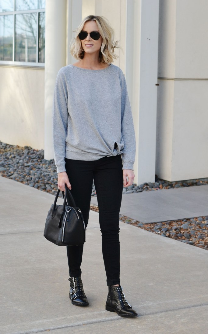 knotted grey sweatshirt, black jeans, buckle boots, casual jeans outfit