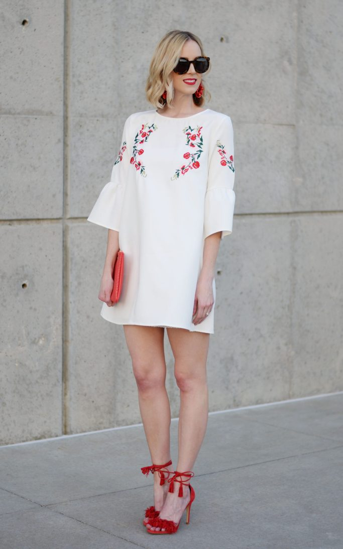 how to stay stylish on a budget, embroidered white dress, red tassel heels, red clutch