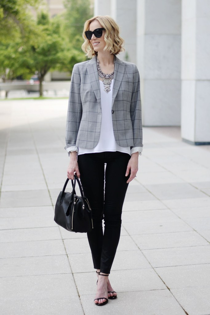tips on styling a grey windowpane blazer, white cami, coated jeans, black denim, heeled black sandals, statement silver necklace, banana republic