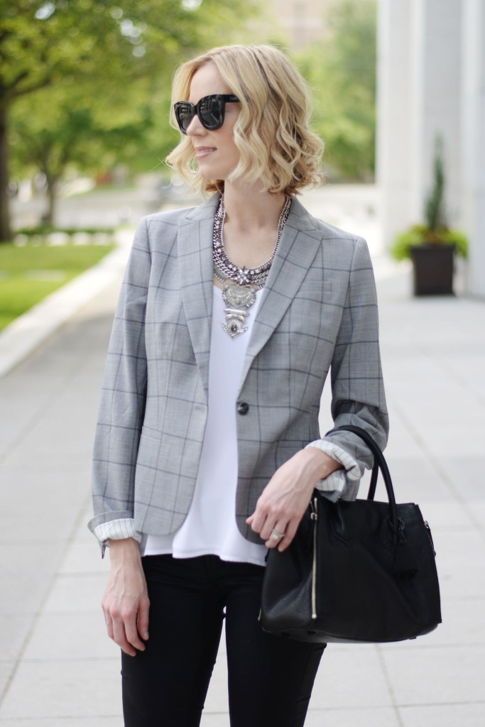 black sunglasses, grey windowpane blazer, white cami, black coated skinny jeans, statement silver necklace, banana republic blazer, black handled bag