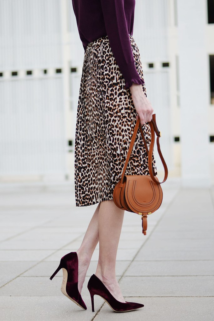 burgundy sweater with ruffle hem sleeves, leopard midi skirt, burgundy velvet heels, fall work outfit idea