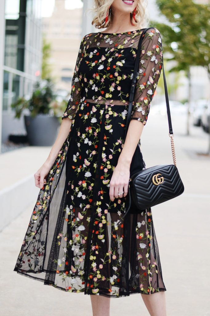 beautiful dark floral embroidery overlay midi dress with sheer paneling and black gucci marmont bag