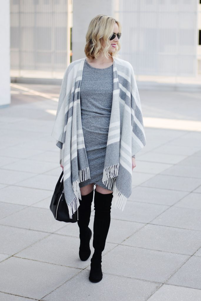 grey ruched dress with black over the knee boots and grey striped poncho