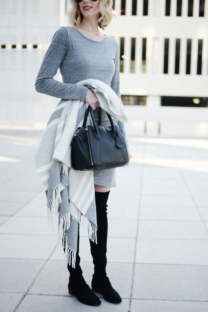grey dress with grey striped poncho