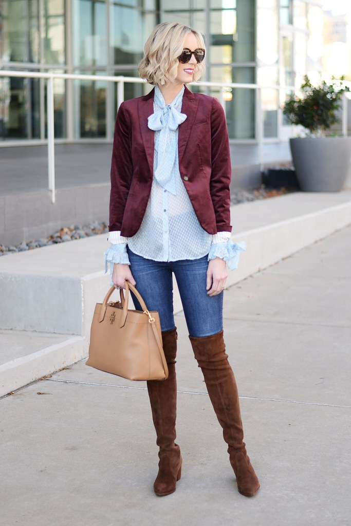 burgundy velvet blazer styled with blouse and over the knee boots, tan tote bag